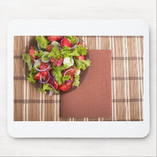 View from above on a plate with fresh salad mouse pad