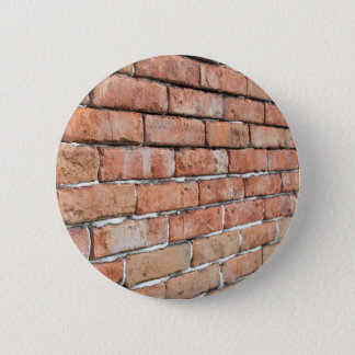 View of an old brick wall with a blur at an angle 2 inch round button