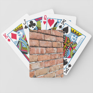 View of an old brick wall with a blur at an angle bicycle playing cards