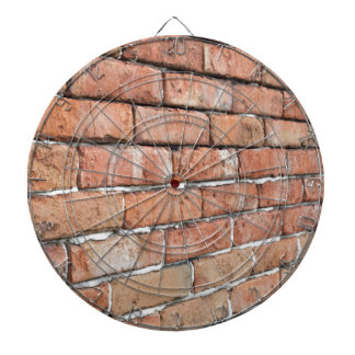View of an old brick wall with a blur at an angle dartboard