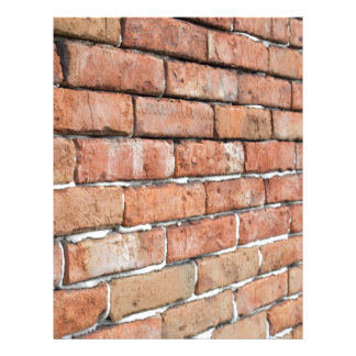 View of an old brick wall with a blur at an angle letterhead