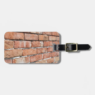 View of an old brick wall with a blur at an angle luggage tag