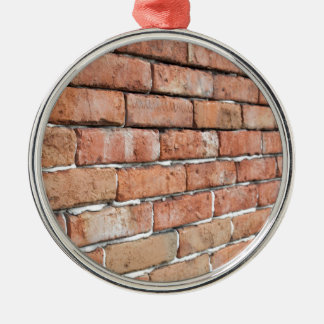 View of an old brick wall with a blur at an angle metal ornament