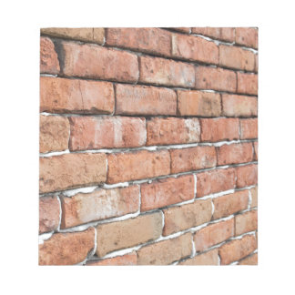 View of an old brick wall with a blur at an angle notepad