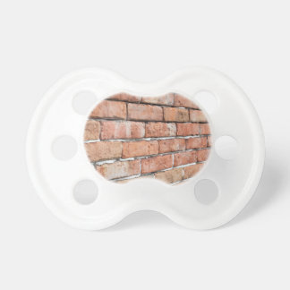 View of an old brick wall with a blur at an angle pacifier