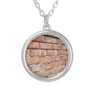 View of an old brick wall with a blur at an angle silver plated necklace