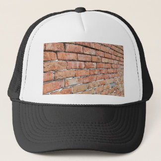 View of an old brick wall with a blur at an angle trucker hat