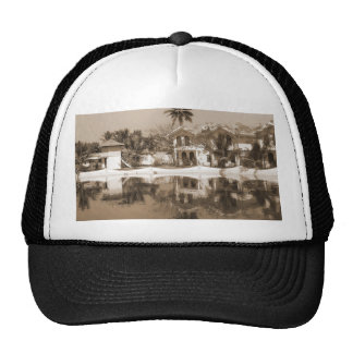 View of cottages and lagoon water in Alleppey Mesh Hats