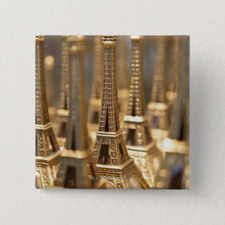 view of small eiffel towers for sale to tourists 2 inch square button