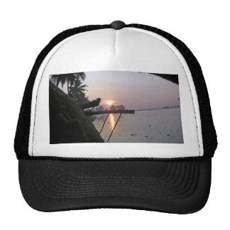 View of sunrise from a houseboat window trucker hat