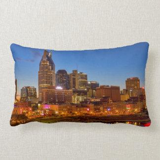 View of the city skyline at dusk lumbar pillow