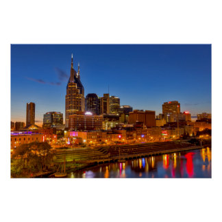 View of the city skyline at dusk poster