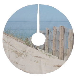 View over the sand dune and beach fence brushed polyester tree skirt