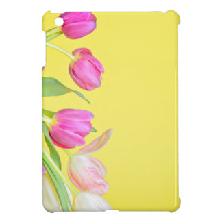View to the multicolored tulips over yellow paper cover for the iPad mini