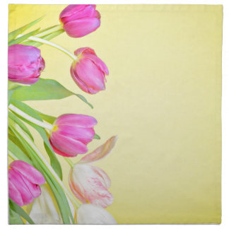 View to the multicolored tulips over yellow paper napkin