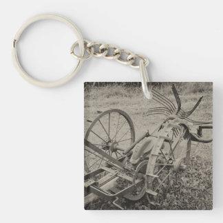 Vintage agricultural machine keychain