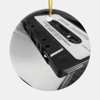 Vintage audio cassette tape on wooden table ceramic ornament
