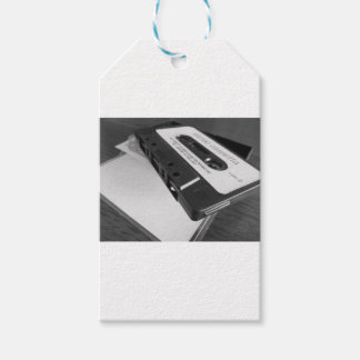 Vintage audio cassette tape on wooden table gift tags