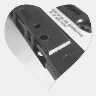 Vintage audio cassette tape on wooden table heart sticker