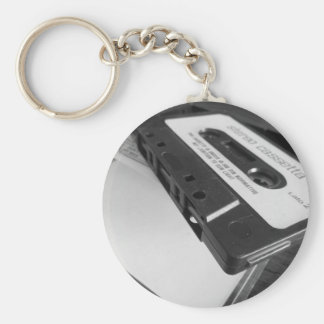 Vintage audio cassette tape on wooden table keychain