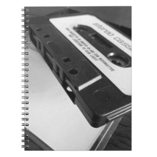Vintage audio cassette tape on wooden table notebook