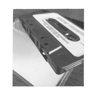 Vintage audio cassette tape on wooden table notepad