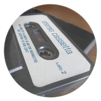 Vintage audio cassette tape on wooden table plate