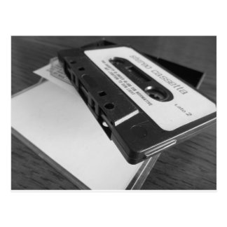 Vintage audio cassette tape on wooden table postcard