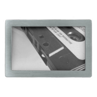 Vintage audio cassette tape on wooden table rectangular belt buckle