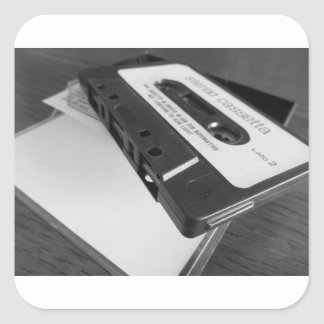 Vintage audio cassette tape on wooden table square sticker