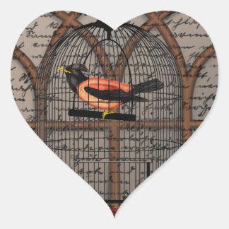 Vintage bird in the cage heart sticker