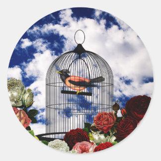 Vintage bird in the cage round sticker