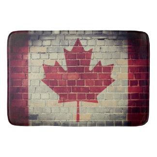 Vintage Canada flag on a brick wall Bath Mat