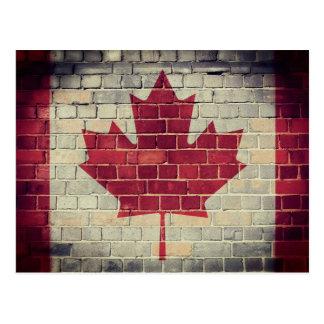 Vintage Canada flag on a brick wall Postcard