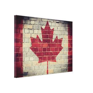 Vintage Canadian flag on a brick wall Canvas Print
