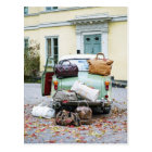 Vintage car with lots of luggage postcard