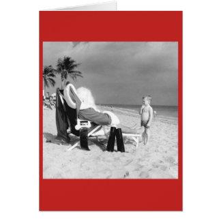 Vintage Child Looking at Santa on Beach Card