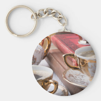 Vintage coffee cups with hot espresso and retro basic round button keychain