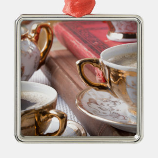 Vintage coffee cups with hot espresso and retro metal ornament