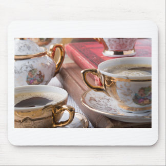 Vintage coffee cups with hot espresso and retro mouse pad