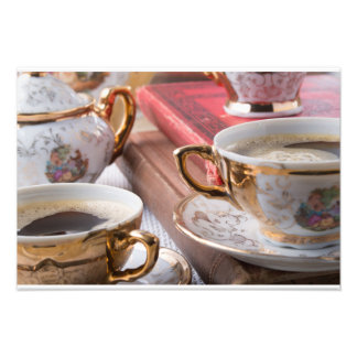 Vintage coffee cups with hot espresso and retro photo print