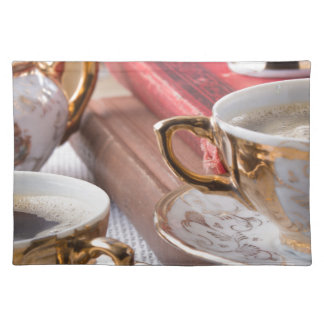 Vintage coffee cups with hot espresso and retro placemat