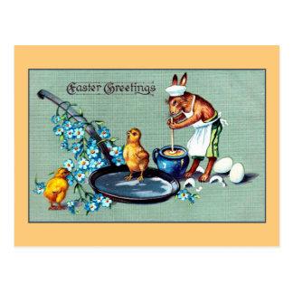 Vintage Easter greetings rabbit making eggs Postcard