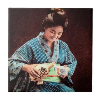 Vintage Geisha Imbibing in a Cup of Sake old Japan Tiles