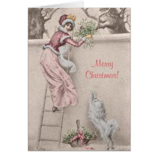 Vintage girl with mistletoe and dog Christmas Card