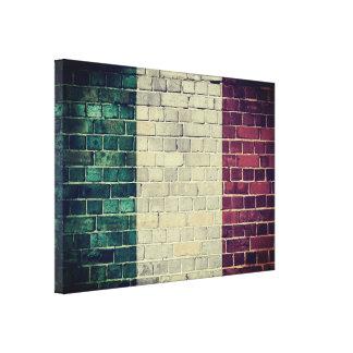 Vintage Italy flag on a brick wall Canvas Print