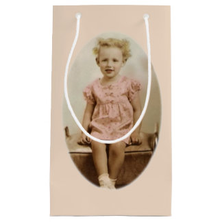 Vintage little blonde girl in pink dress gift bag