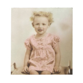 Vintage little blonde girl in pink dress notepad