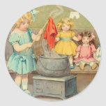 Vintage Little Girl Playing With Dolls Round Stickers