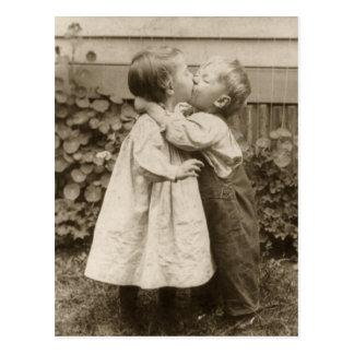 Vintage Love Photo of Children Kissing in a Garden Postcard